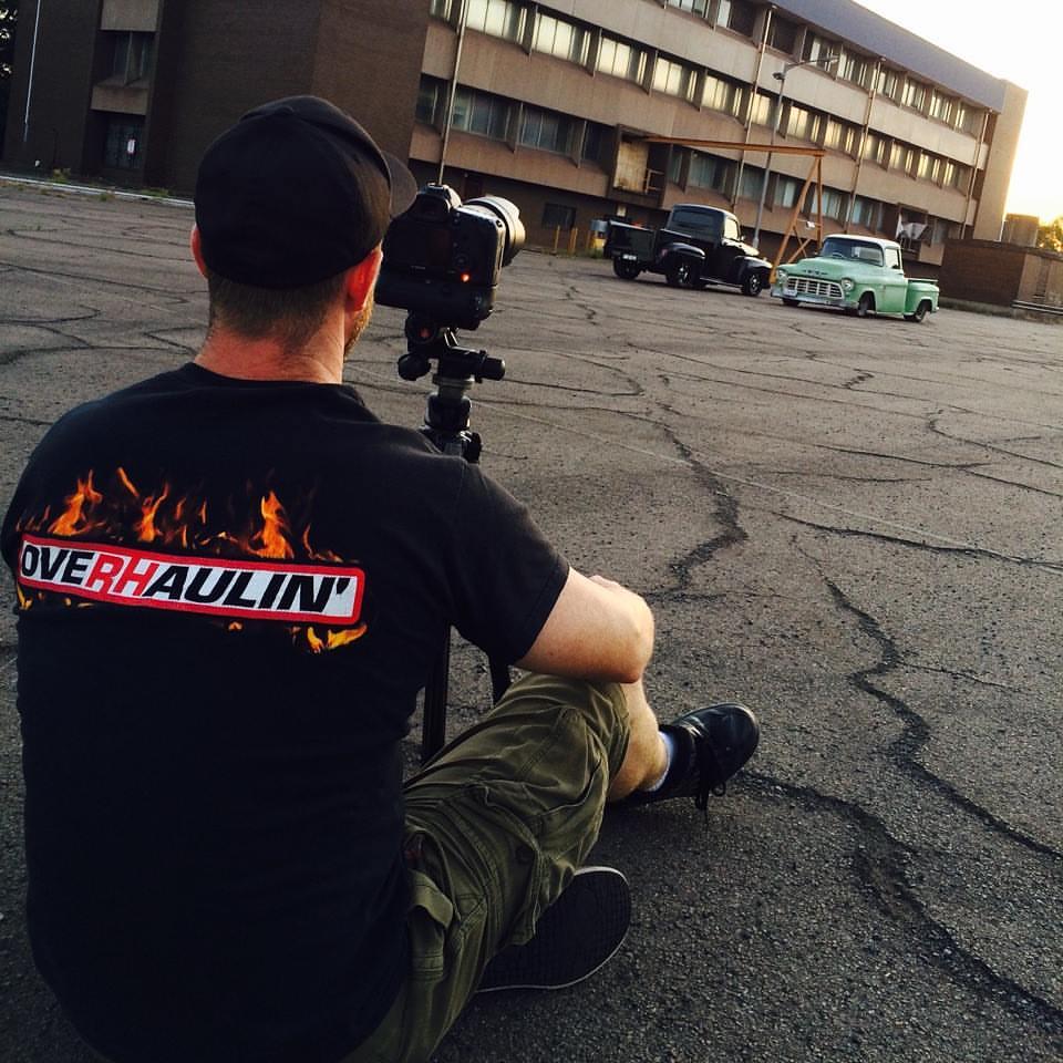 Ben Hosking photographing two pickup trucks