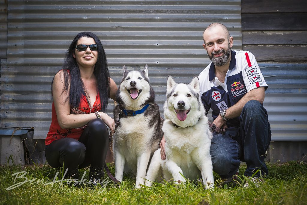 Couple of people and husky dogs